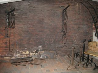 This is the hearth used for cooking smaller dishes. Note the swing arm used for suspending a kettle.