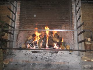 The roasting fireplace. The iron grates on each side are for suspending multiple=